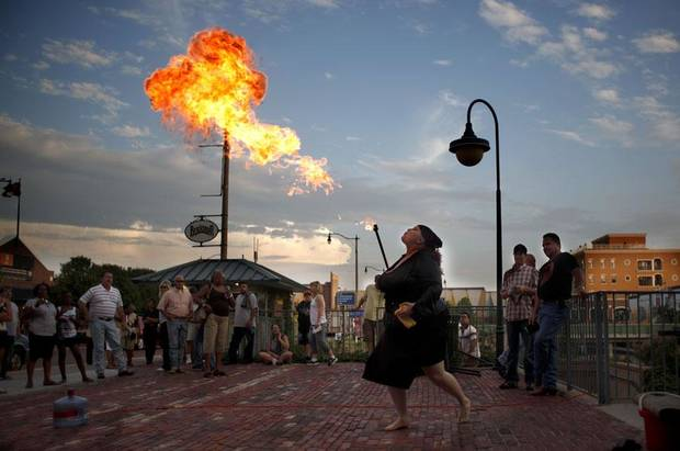 The Amazing Boobzilla breathes fire during the Carnival of Cleavage sideshow, Friday, June 11, 2010, in Bricktown in Oklahoma City. Photo by Sarah Phipps, The Oklahoman     ORG XMIT: KOD