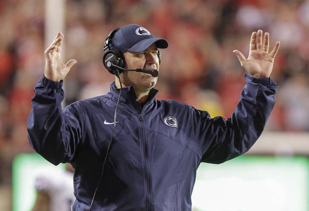 Penn State head coach Bill O'Brien makes the touchdown gesture as officials rule that Penn State's Matt Lehman fumbled the ball before entering Nebraska's end zone in the second half of an NCAA college football game in Lincoln, Neb., Saturday, Nov. 10, 2012. Nebraska won 32-23. (AP Photo/Nati Harnik)