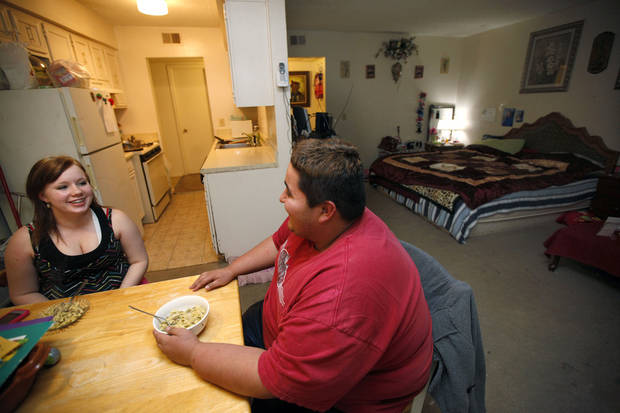 Renae and Juan talk during dinner at her Oklahoma City home, Thursday, Feb. 9, 2012. Photo by Sarah Phipps, The Oklahoman