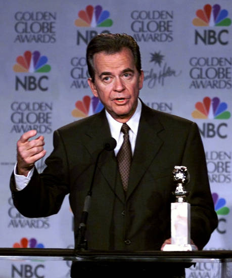 Entertainer Dick Clark addresses the media prior to announcing the 1999 Golden Globes nominations at the Beverly Hilton in Beverly Hills, Calif., Monday, Dec. 20, 1999. The Golden Globes air Jan. 23 on NBC. (AP Photo/Victoria Arocho)