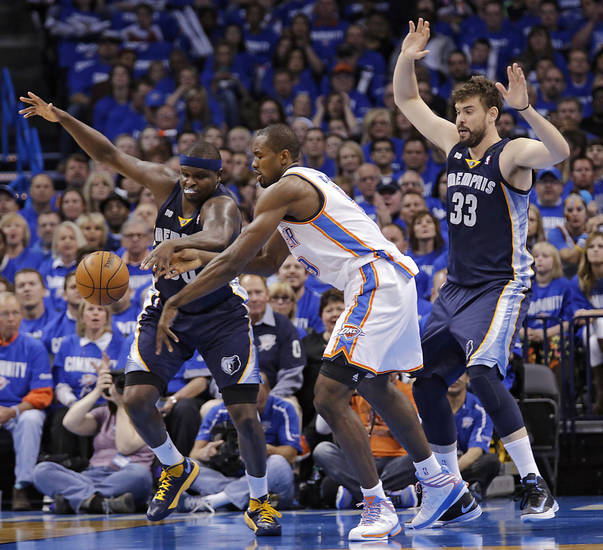 Oklahoma City's Serge Ibaka (9) defends on Memphis' Zach Randolph (50) and Marc Gasol (33) during the second round NBA playoff basketball game between the Oklahoma City Thunder and the Memphis Grizzlies at Chesapeake Energy Arena in Oklahoma City, Sunday, May 5, 2013. Photo by Chris Landsberger, The Oklahoman