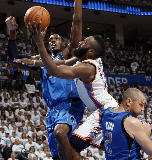 Oklahoma City's James Harden (13) tries to get between Dallas' Ian Mahinmi (20) and Jason Kidd (2) during Game 2 of the first round in the NBA basketball  playoffs between the Oklahoma City Thunder and the Dallas Mavericks at Chesapeake Energy Arena in Oklahoma City, Monday, April 30, 2012.  Oklahoma City won, 102-99. Photo by Nate Billings, The Oklahoman