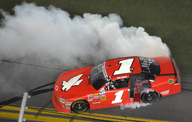 Kurt Busch spins out after winning the Nationwide Series NASCAR auto race at the Daytona International Speedway in Daytona Beach, Fla., Friday, July 6, 2012. (AP Photo/Phelan M. Ebenhack)
