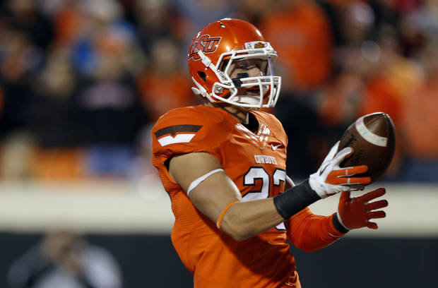 Oklahoma State&#039;s Zack Craig (23) scores a touchdown on a blocked punt during a college football game between Oklahoma State University and the Texas Tech University (TTU) at Boone Pickens Stadium in Stillwater, Okla., Saturday, Nov. 17, 2012. Photo by Sarah Phipps, The Oklahoman