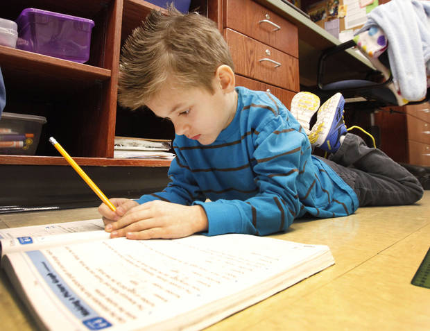 Second-grader Schaefer Climents works on a math lesson at Centennial Elementary School in Edmond. Photo By David McDaniel, The Oklahoman