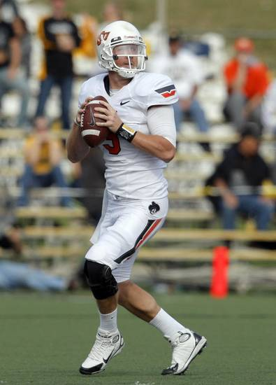 Oklahoma State's Brandon Weeden (3) looks to pass the ball during a college football game between the Oklahoma State University Cowboys (OSU) and the University of Missouri Tigers (Mizzou) at Faurot Field in Columbia, Mo., Saturday, Oct. 22, 2011. Photo by Sarah Phipps, The Oklahoman