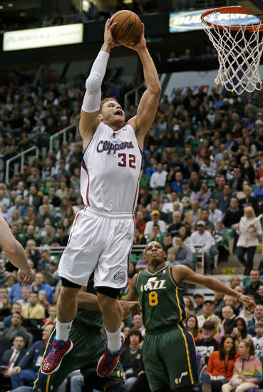 Los Angeles Clippers power forward Blake Griffin (32) dunks as Utah Jazz point guard Randy Foye (8) looks on in the first quarter of an NBA basketball game on Friday, Dec. 28, 2012, in Salt Lake City. (AP Photo/Rick Bowmer)