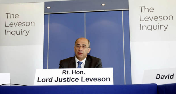   FILE - In this July 28, 2011 file photo, Lord Justice Brian Leveson speaks during the first formal session of his phone hacking inquiry in London. Leveson, who spent a year investigating the misdeeds of Britain&#039;s lively newspapers, is giving Britain&#039;s Prime Minister David Cameron an early look at his recommendations on Wednesday, Nov. 28, 2012 for the regulation of the press. (AP Photo/Sean Dempsey, Pool-File)  