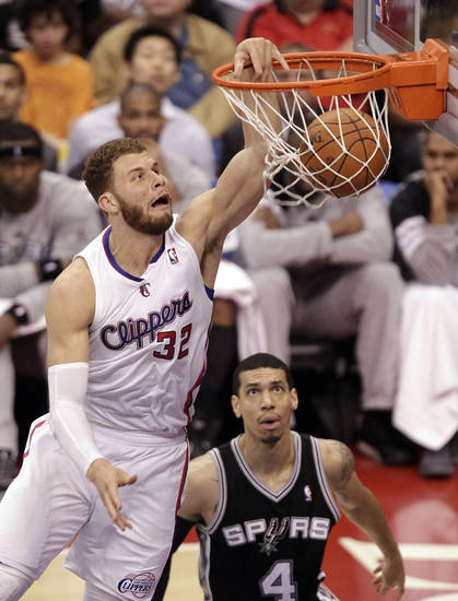 Los Angeles Clippers' Blake Griffin dunks as San Antonio Spurs' Daniel Green, bottom center, looks on during the second half in Game 4 of an NBA basketball playoffs Western Conference semifinal in Los Angeles, Sunday, May 20, 2012. (AP Photo/Jae C. Hong)