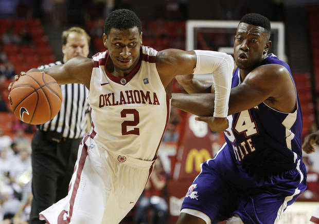 Oklahoma's Steven Pledger drives the ball past Northwestern's Gary Roberson (34) during a men's college basketball game between the University of Oklahoma and Northwestern Louisiana State University at the Lloyd Noble Center in Norman, Okla., Friday, Nov. 30, 2012.  Photo by Garett Fisbeck, The Oklahoman