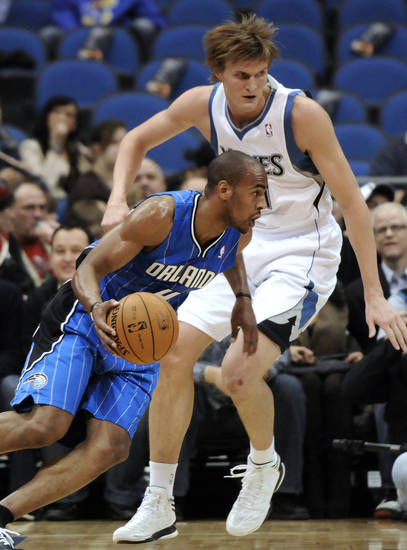 Orlando Magic's Arron Afflalo, left, drives around Minnesota Timberwolves' Andrei Kirilenko, of Russia, during the first half of an NBA basketball game Wednesday, Nov. 7, 2012, in Minneapolis. (AP Photo/Jim Mone)