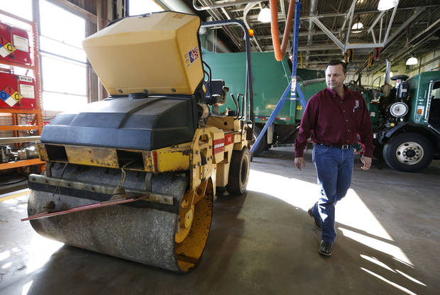 Fleet Manager Mike White shows some of Norman's fleet of vehicles, including this 1995 Dynapac Steel Sheet Roller that needs some hard-to-find replacement parts. PHOTO BY STEVE SISNEY, THE OKLAHOMAN <strong>STEVE SISNEY</strong>