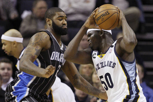 Memphis Grizzlies' Zach Randolph (50) is pressured by Orlando Magic's Kyle O'Quinn (2) during the first half of an NBA basketball game in Memphis, Tenn., Friday, Feb. 22, 2013. (AP Photo/Danny Johnston)