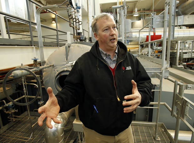 University of Oklahoma facilities manager Brian Ellis stands in front of heat transfer units in the new power/heat/air conditioning facility as he shows energy saving enhancements to the Norman campus on Tuesday, Nov. 27, 2012 in Norman, Okla.  Photo by Steve Sisney