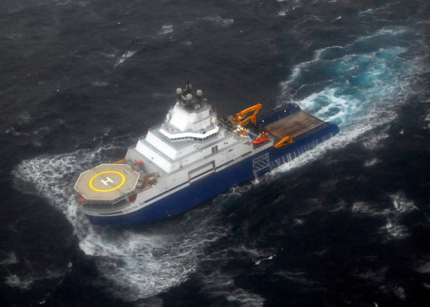 In this photo provided by the U.S. Coast Guard, the tug Aiviq travels at just under 2 mph with the mobile drilling unit Kulluk in tow 116 miles southwest of Kodiak City, Alaska, Sunday, Dec. 30, 2012. The crews remain stationed with the drill rig Kulluk Sunday 20 miles from Alaska's Kodiak Island as they wait in rough seas for another tug boat to arrive. The Coast Guard says the goal is to tow the Kulluk to a safe harbor and determine the next step. (AP Photo/U.S Coast Guard, Chris Usher)