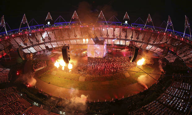Fireworks explode while artists perform during the Opening Ceremony of the 2012 Olympic Summer Games at the Olympic Stadium in London, Friday, July 27, 2012. (AP Photo/Ezra Shaw, Pool)
