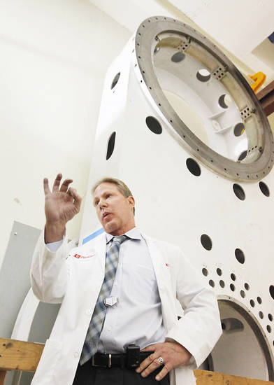 Left: Dr. Terence Herman discusses proton cancer therapy at the Peggy and  Charles Stephenson Cancer Center. PHOTO BY DAVID MCDANIEL, THE OKLAHOMAN