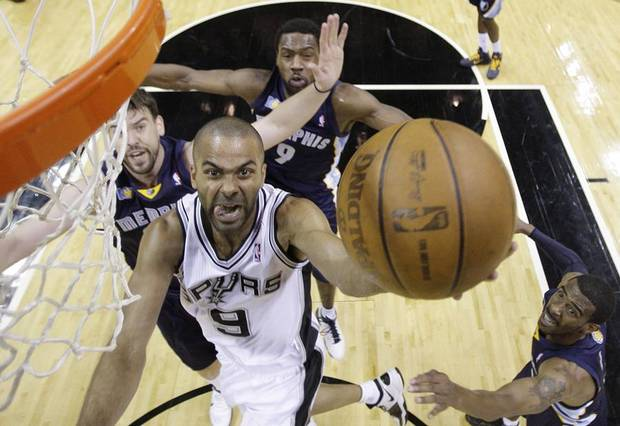 San Antonio Spurs' Tony Parker (9), of France, drives to the basket as Memphis Grizzlies' Marc Gasol, left, of Spain, Tony Allen (9) and Mike Conley, right, defend during the first quarter of Game 2 of a first-round NBA basketball playoff series, Wednesday, April 20, 2011, in San Antonio. (AP Photo/Eric Gay) ORG XMIT: TXEG107