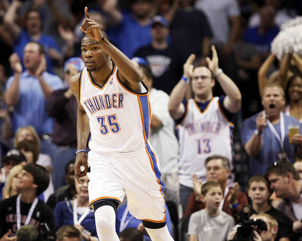 Oklahoma City's Kevin Durant (35) reacts after making a shot during the NBA basketball game between the Miami Heat and the Oklahoma City Thunder at Chesapeake Energy Arena in Oklahoma City, Sunday, March 25, 2012. Photo by Nate Billings, The Oklahoman