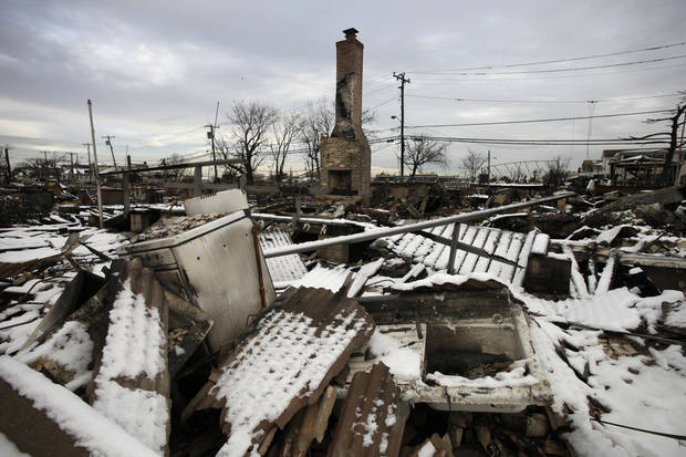 A fire-scorched landscape of Breezy Point is shown after a Nor'easter snow, Thursday, Nov. 8, 2012 in New York.  The beachfront neighborhood was devastated during Superstorm Sandy when a fire pushed by the raging winds destroyed many homes.  (AP Photo/Mark Lennihan) ORG XMIT: NYML105