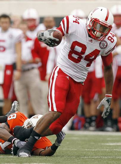 Nebraska's Brandon Kinnie slips past OSU's Devin Hedgepeth on a touchdown run during the college football game between the Oklahoma State Cowboys (OSU) and the Nebraska Huskers (NU) at Boone Pickens Stadium in Stillwater, Okla., Saturday, Oct. 23, 2010. Photo by Sarah Phipps, The Oklahoman