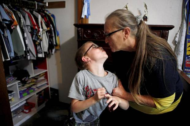GRANDPARENTS: Yvonne Underhill kisses her grandson Jeremy Underhill, 7, after school in their Choctaw, Okla., home on Thursday, September 9, 2010.  Photo by Bryan Terry, The Oklahoman ORG XMIT: KOD