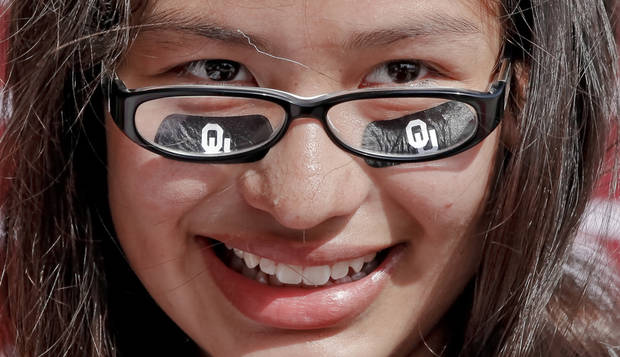 FANS / UNIVERSITY OF OKLAHOMA / COLLEGE FOOTBALL: Cassidy Davis, of Norman, show her support for the Sooners by wearing OU eye black during the Bevo Bash on Friday, Oct. 12, 2012, in Marietta, Okla. Photo by Chris Landsberger, The Oklahoman