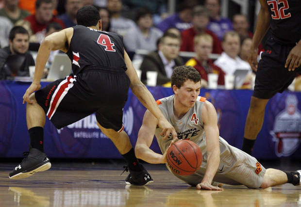 Oklahoma State's Christien Sager (15) dives for a loose ball as Texas Tech's Ty Nurse (4) defends during the Big 12 tournament men's basketball game between the Oklahoma State Cowboys and the Texas Tech Red Raiders at the Sprint Center, Wednesday, March, 6, 2012. Photo by Sarah Phipps, The Oklahoman