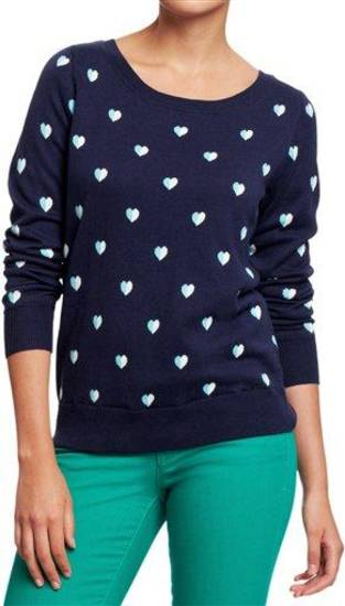 This undated publicity photo provided by Old Navy shows a crewneck sweater with a heart motif available at Old Navy. The good, the bad, the kitschy. A &quot;seasonal sweater&quot; is one way to start a conversation at a holiday function. (AP Photo/Old Navy)