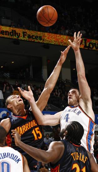 Oklahoma City&#039;s Nick Collison shoots over the defense of Andris Biedrins of Golden State in the second half during the NBA basketball game between the Golden State Warriors and the Oklahoma City Thunder at the Ford Center in Oklahoma City, Monday, December 8, 2008. Golden State won, 112-102.  BY NATE BILLINGS, THE OKLAHOMAN