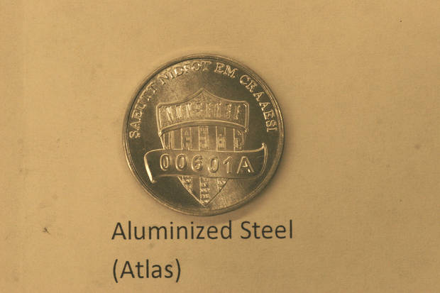 This undated photo provided on Wednesday, Dec. 19, 2012 by the U.S. Mint in Philadelphia shows a nonsense test piece.  The Mint has been testing different materials to fiend less expensive ways to make coins. (AP Photo U.S. Mint) ORG XMIT: PX202