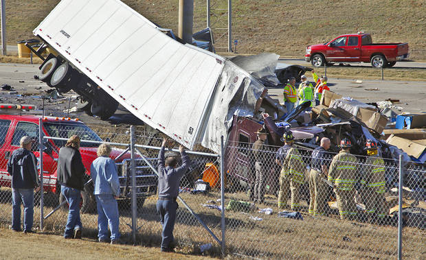 Crews work the scene of a wreck that involved two semi-trucks where one man was killed in a tractor-trailer rig accident on Interstate 35 near NE 122 Avenue on Friday, Jan. 6, 2012, in Oklahoma City, Okla.  Photo by Chris Landsberger, The Oklahoman