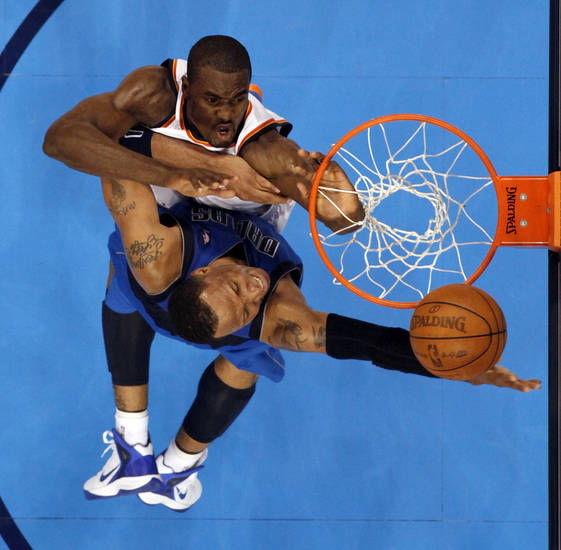 Oklahoma City's Serge Ibaka (9) defends Dallas' Shawn Marion (0) during game one of the first round in the NBA playoffs between the Oklahoma City Thunder and the Dallas Mavericks at Chesapeake Energy Arena in Oklahoma City, Saturday, April 28, 2012. Oklahoma City won, 99-98. Photo by Nate Billings, The Oklahoman