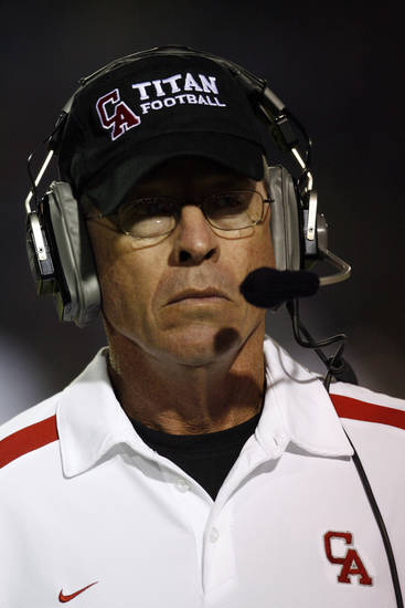 Carl Albert head coach Gary Rose watches as the Titans play Guthrie in high school football at Jim Harris Stadium  in Midwest City, Oklahoma on Thursday October 16, 2008.  