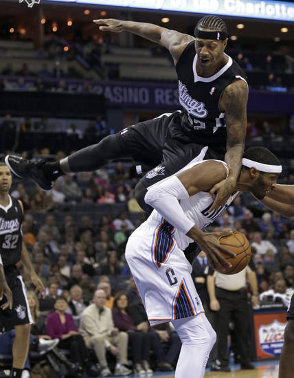Sacramento Kings' Francisco Garcia, top, falls over Charlotte Bobcats' Hakim Warrick, bottom, during the first half of an NBA basketball game in Charlotte, N.C., Saturday, Jan. 19, 2013. (AP Photo/Chuck Burton)