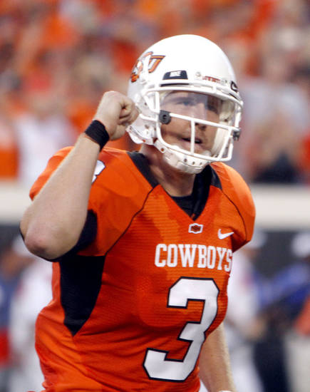 Oklahoma State quarterback Brandon Weeden (3) celebrates a touchdown during the college football game between the University of Tulsa (TU) and Oklahoma State University (OSU) at Boone Pickens Stadium in Stillwater, Oklahoma, Saturday, September 18, 2010. Photo by Sarah Phipps, The Oklahoman