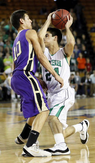 Bishop McGuinness' Luis Lopez (24) tries to get around Chickasha's Dakota Goombi (10) during a Class 5A boys high school basketball game in the semifinals of the state tournament at the Mabee Center in Tulsa, Okla., Friday, March 8, 2013. Photo by Nate Billings, The Oklahoman
