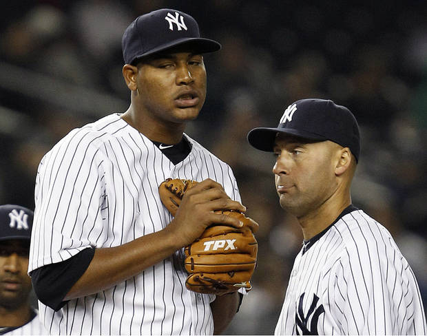 New York Yankees shortstop Derek Jeter, right, approaches the mound as starting pitcher Ivan Nova reacts in the seventh inning before being pulled by manager Joe Girardi during a baseball game against the Baltimore Orioles at Yankee Stadium in New York, Wednesday, May 2, 2012. (AP Photo/Kathy Willens)