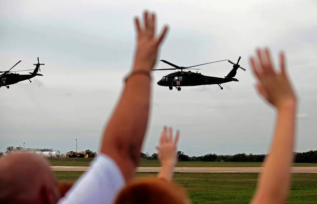Family and friends wave good bye to soldiers following an Oklahoma Aviation Command mobilization ceremony  for Detachment 1, Company C, 2-149th General Support Aviation Battalion at the Army Aviation Support Facility in Lexington, Okla., Thursday, Jan. 24, 2008. The soldiers will receive additional training at Fort Hood before being deployed to Afghanistan. Photo by Sarah Phipps, The Oklahoman