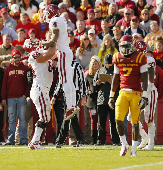 Oklahoma's Kenny Stills (4) and Gabe Ikard (64) celebrate a touchdown by Stills in the fourth quarter during a college football game between the University of Oklahoma (OU) and Iowa State University (ISU) at Jack Trice Stadium in Ames, Iowa, Saturday, Nov. 3, 2012. OU won, 35-20. Photo by Nate Billings, The Oklahoman