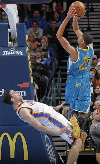 New Orleans Hornets' Anthony Davis (23) shoots over Oklahoma City Thunder's Nick Collison (4) during the NBA basketball game between the Oklahoma CIty Thunder and the New Orleans Hornets at the Chesapeake Energy Arena on Wednesday, Dec. 12, 2012, in Oklahoma City, Okla.   Photo by Chris Landsberger, The Oklahoman