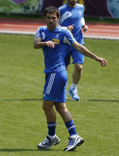Greece's captain Giorgos Karagounis exercises during the training session at the Euro 2012 soccer championship in Legionowo about 25 kilometers (15 miles) north of Warsaw, Poland on Monday, June 18, 2012. (AP Photo/Thanassis Stavrakis)