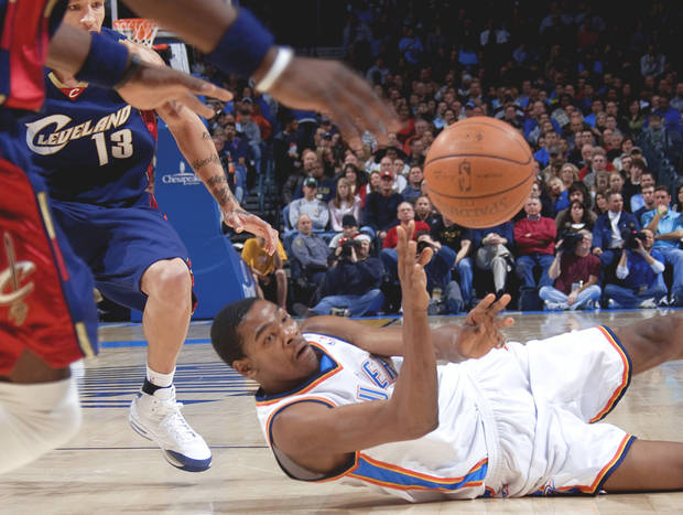 Oklahoma City's Kevin Durant scrambles for a loose ball during Sunday's game at the Ford Center. PHOTO BY SARAH PHIPPS, THE OKLAHOMAN