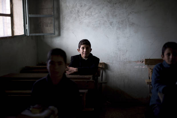 A Syrian child attends class in a city under control of the Free Syrian Army in Aleppo province, Syria, Thursday, Dec. 13, 2012. (AP Photo/Manu Brabo) ORG XMIT: CAI119