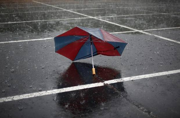 An umbrella sits abandoned, during a thunderstorm, Sunday, April 24, 2011, in Norman, Okla.  Photo by Sarah Phipps, The Oklahoman