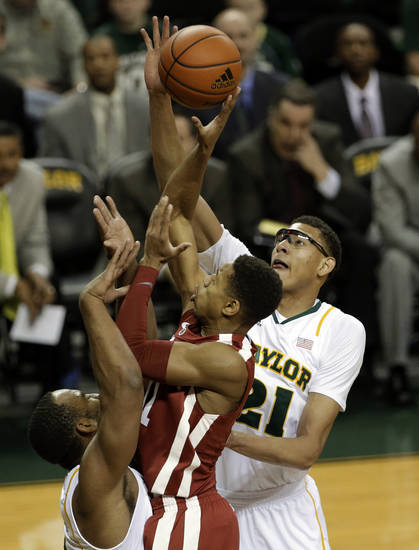 Oklahoma guard Isaiah Cousins (11) has his shot blocked by Baylor center Isaiah Austin (21) with help from Rico Gathers, bottom left, during the first half of an NCAA college basketball game Wednesday, Jan. 30, 2013, in Waco, Texas. (AP Photo/Tony Gutierrez)