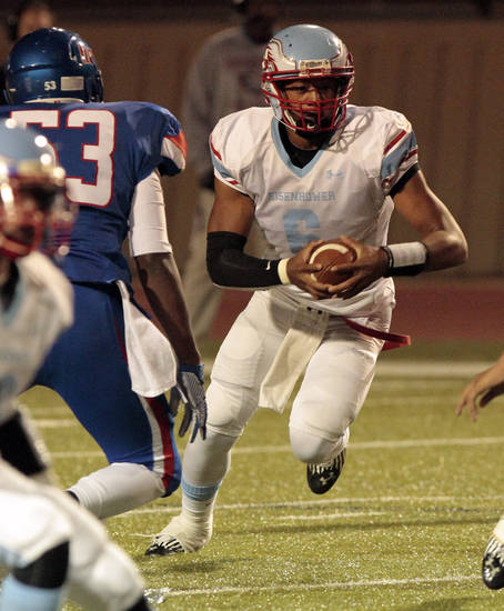 Lawton Eisenhower's Chris Pogi runs as the Moore Lions play the Lawton Eisenhower Eagles in a high school football game on Friday, Oct. 5, 2012, in Moore, Okla.  Photo by Steve Sisney, The Oklahoman