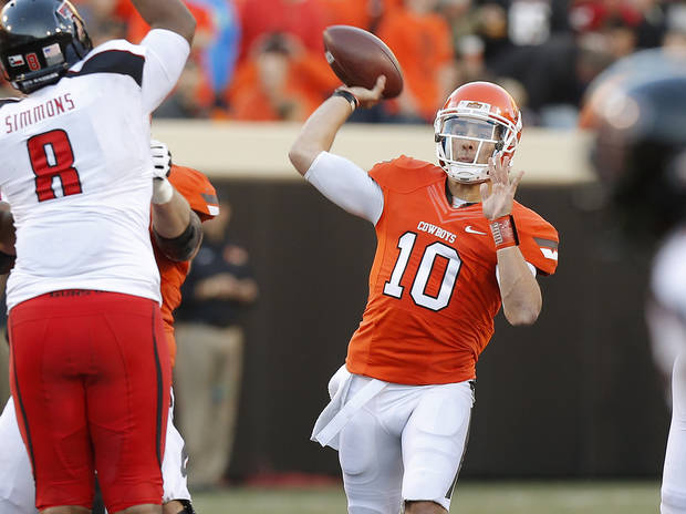 Oklahoma State&#039;s Clint Chelf (10) throws a pass during a college football game between Oklahoma State University (OSU) and Texas Tech University (TTU) at Boone Pickens Stadium in Stillwater, Okla., Saturday, Nov. 17, 2012.  Photo by Bryan Terry, The Oklahoman