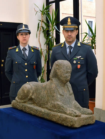 This photo provided Thursday, Dec. 6, 2012 by the Italian Finance police shows an Egyptian sphinx confiscated by police from a greenhouse near Rome. On Thursday Italian Finance police found an ancient Egyptian sphinx, measuring 120 cm (47 inches) long and 60 cm (23 inches) tall, believed to date back to the Ptolemaic Era, between the IV and the I century B.C, hidden in a greenhouse, already packed in a case and allegedly ready to be smuggled abroad. (AP Photo/Courtesy of Italian Finance police, ho)