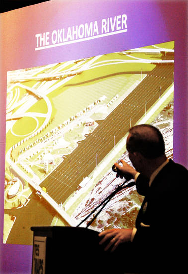 Mayor Mick Cornett gestures at an architect's rendering of the Oklahoma River in October while talking about MAPS 3 during a luncheon in downtown Oklahoma City.  PHOTO BY PAUL B. SOUTHERLAND, THE OKLAHOMAN